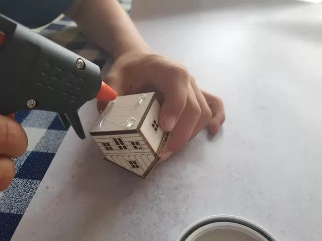 using the glue gun on house decoration