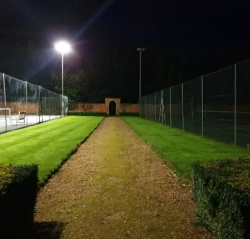 inbetween floodlit tennis courts