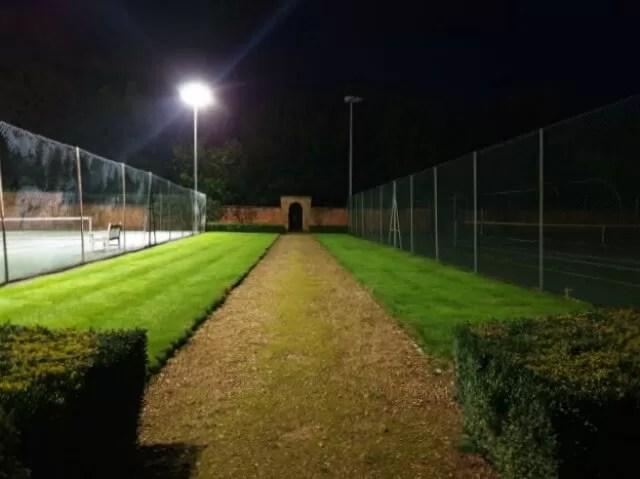 inbetween floodlit tennis courts
