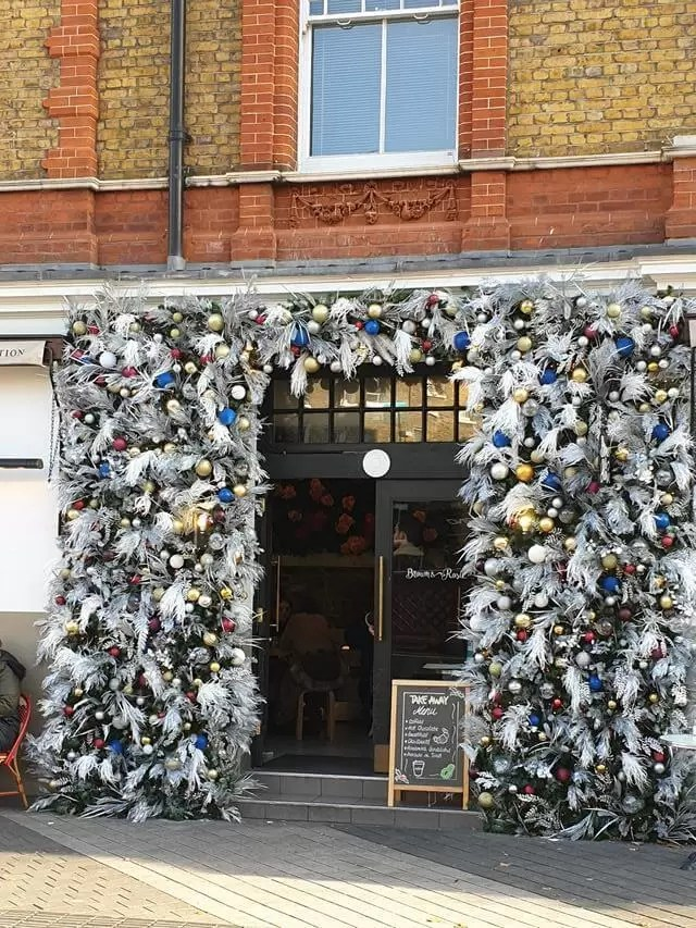 christmas decorations around a pub door