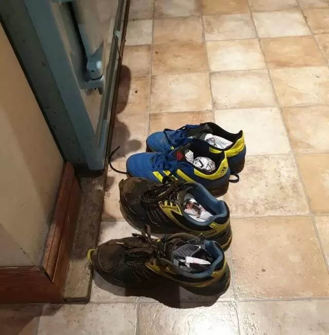 muddy trainers in front of the aga