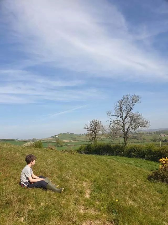 sitting on a hill watching over the countryside