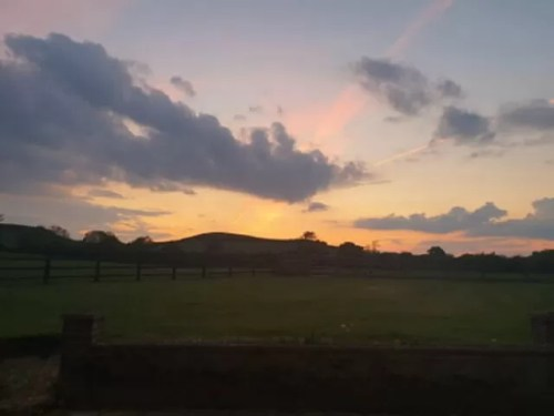 sunset over the farm hills