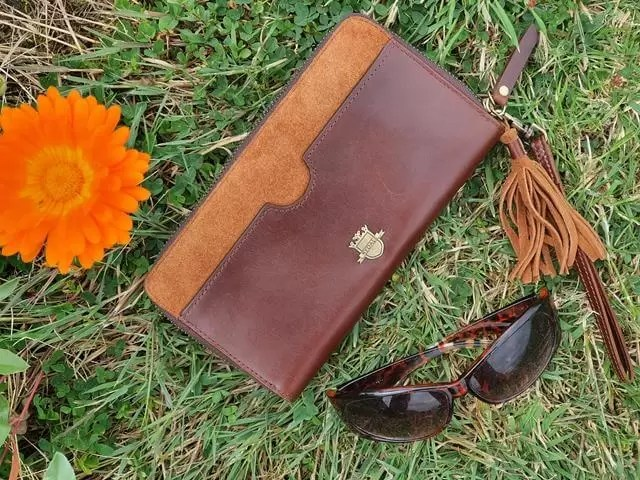 Rydale tan suede and leather cluth purse with brown sunglasses