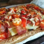 cooked super loaded potato bacon tomato and cheese tart