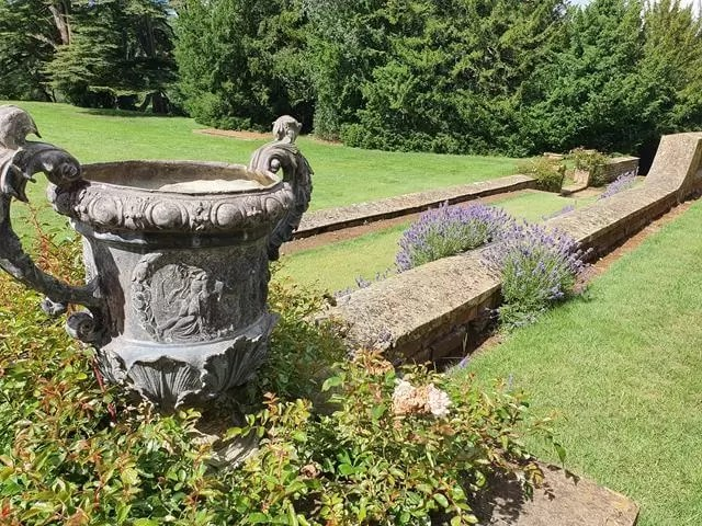 large stone urn in the arden