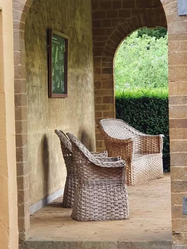 rattan chairs in an archway