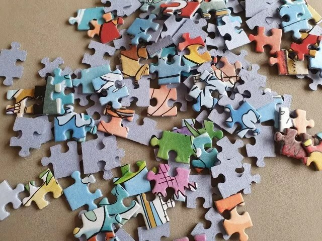 sorting puzzle pieces at the start of a puzzle