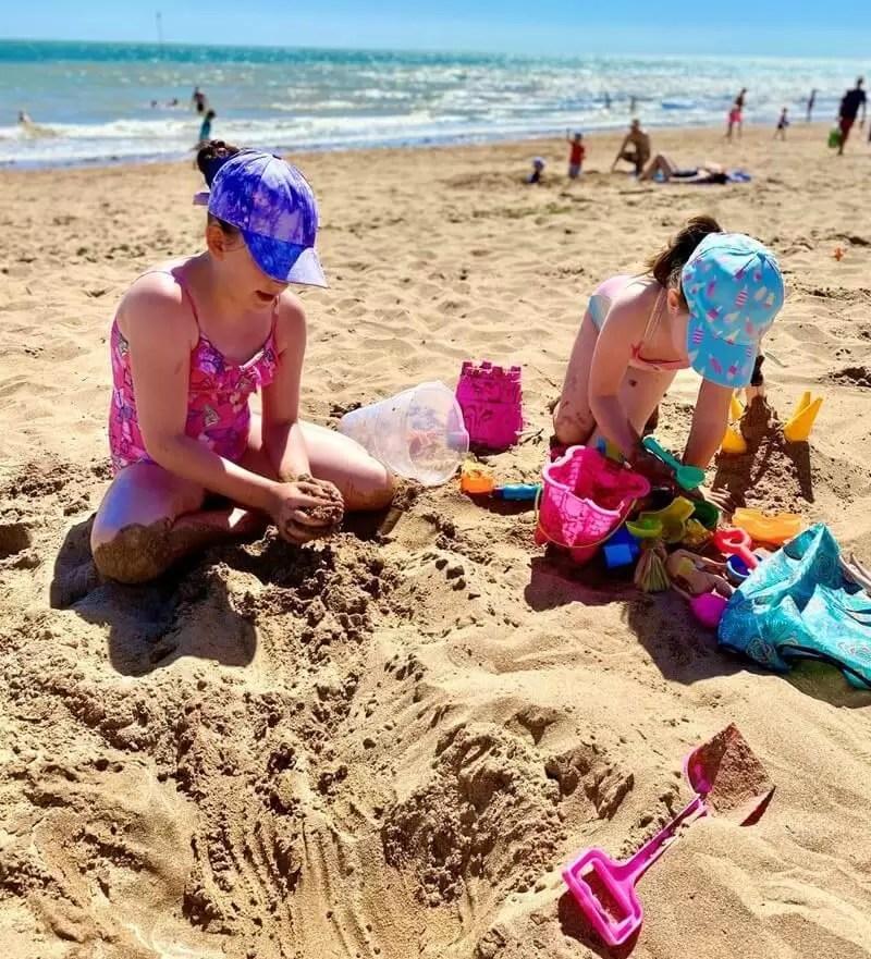 2 girls playing on beach