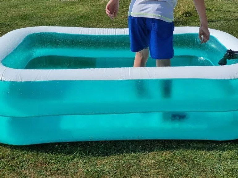 standing in the paddling pool