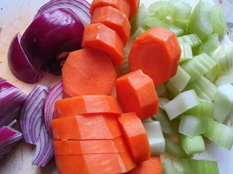 raw red onion carrot and celery chopped ready for casseole