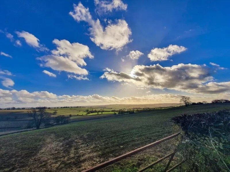 view of blue sky over fields