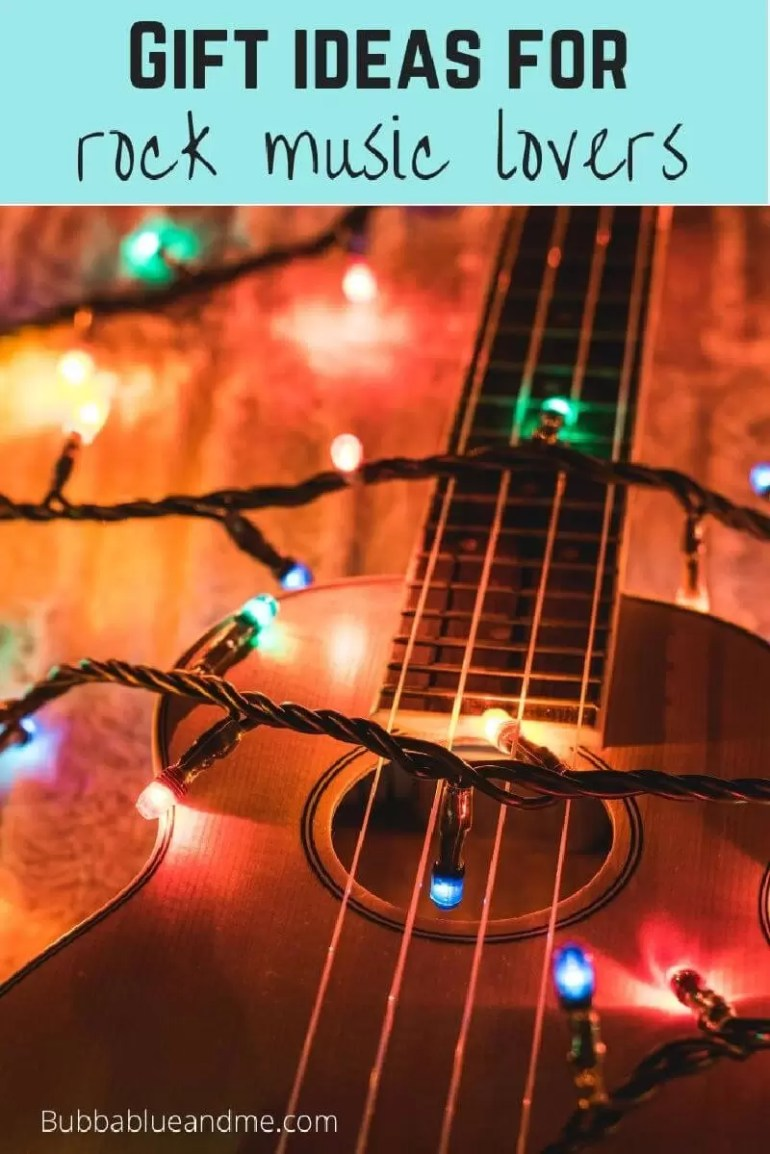 gift ideas for rock music lovers, zoomed in guitar with multicoloured fairly lights draped over.