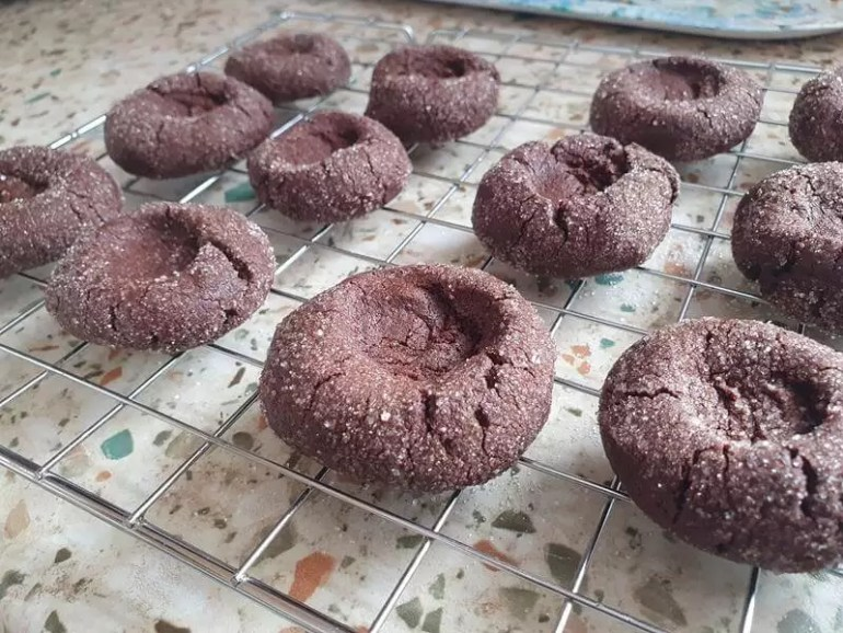 baked cooling chocolate thumbprint cookies