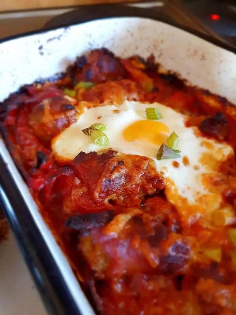baked egg on sausage and tomato bake