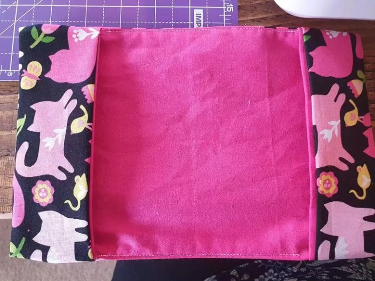 top stitch over the lengths to close the gap from the pockets
