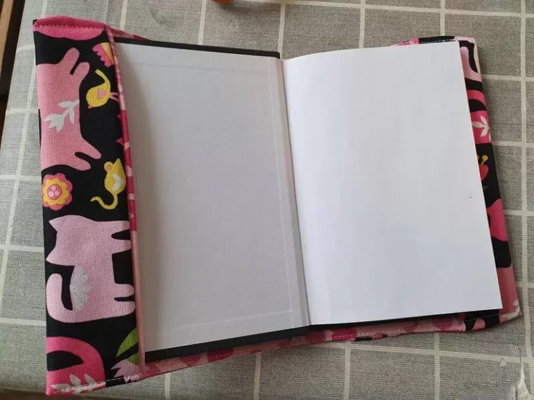 put the notebook into the fabric cover