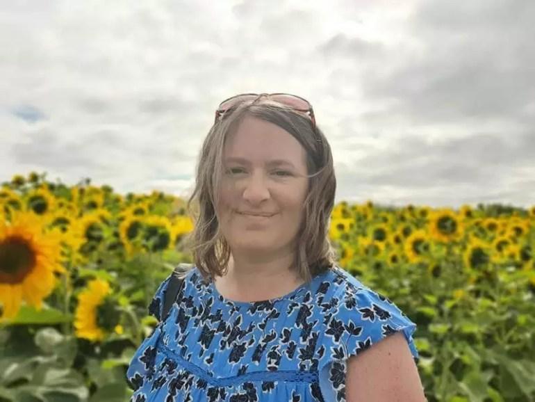 selfie against sunflower fields in sunshine