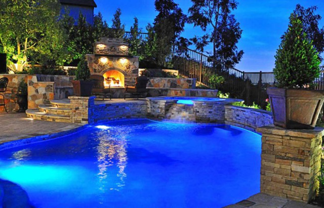 backyard blue pool fireplace