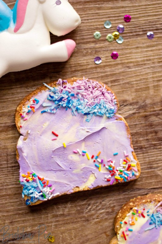 Easy Unicorn Toast On a table with fun, colorful decorations.