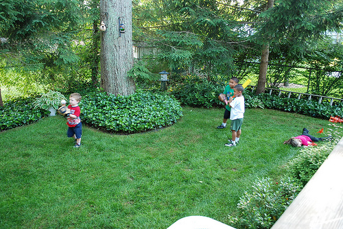 Austin, Larry and Gavin playing ball, Alison apparently knocked out cold
