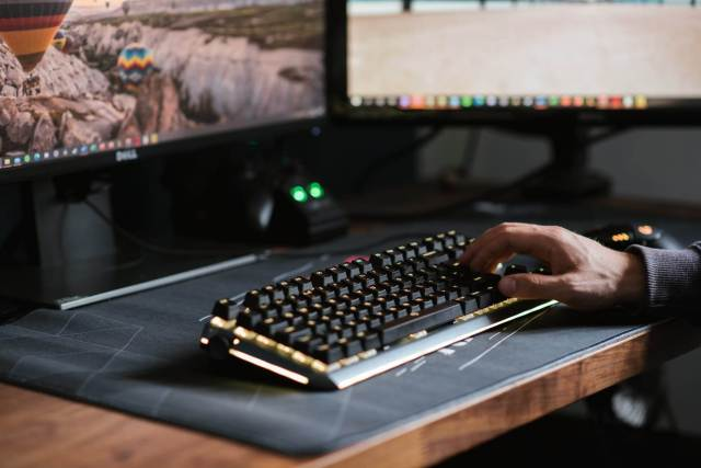 A man is typing on his keyboard