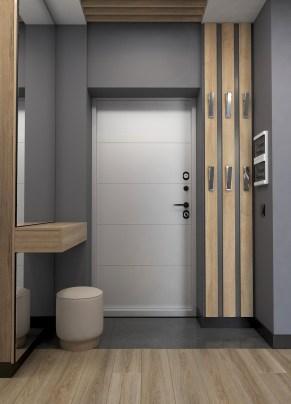Дизайн интерьера прихожей в серых тонах.