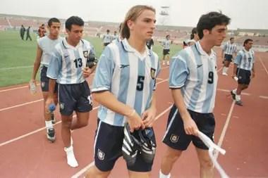 Cuchu Cambiasso, Peralta y Javier Villarreal, tras uno de los encuentros en suelo africano
