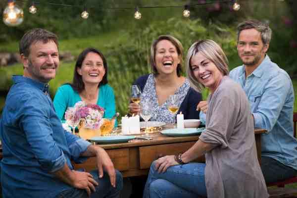 A,Summer,Evening,Of,Friends,In,Their,40s,Gather,Around