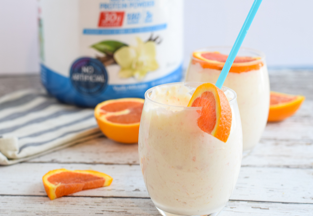 This Tropical Creamsicle Post Workout Smoothie is the perfect cold, creamy and refreshing liquid after a workout. Full of carbohydrates, protein and electrolytes, it's a great way to balance your nutrition needs after exercise | Post Workout Smoothie | Protein Smoothie