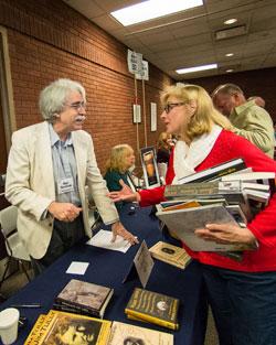 Author Mark Dawidziak chats with a Buckeye Book Fair attendee.