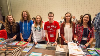 This group of Buckeye Book Fair volunteers assists authors by bringing them more books when needed.