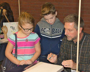 Artist and art instructor Mark Willenbrink gives a short drawing demonstration for BBF attendees.
