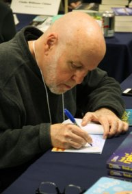 Author and former US Children's Poet Laureate J. Patrick Lewis autographs one of his books