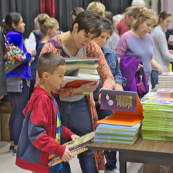 BBF attendees pick out their books.