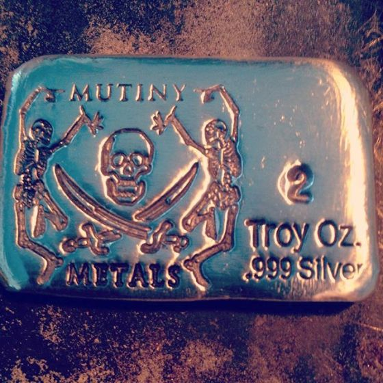 stamped image in silver bullion cube for Mutiny Metals Silver Stamp custom made by Buckeye Engraving