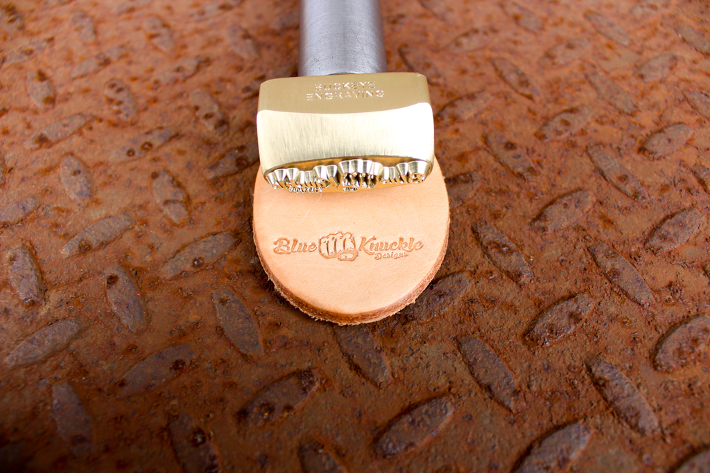 Blue Knuckle Designs custom Leather Hand Stamp made in brass with leather embossed with it shown by Buckeye Engraving