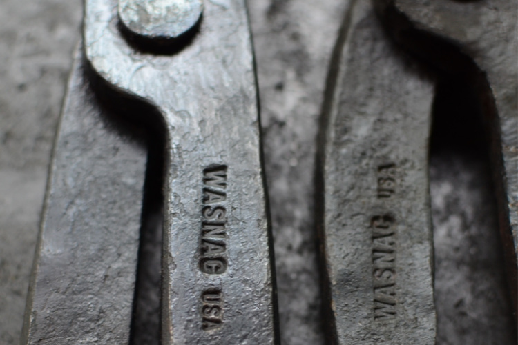 close up view of touch mark stamp of Blacksmith made pliers stamp crafted by Buckeye Engraving