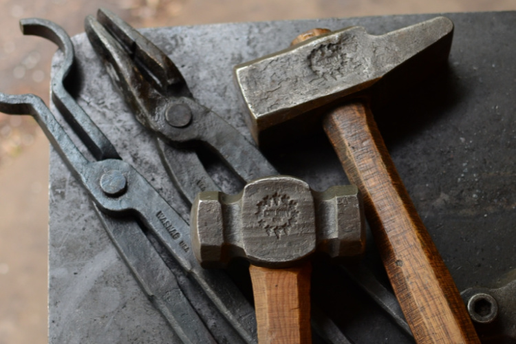 blacksmith made tongs and hammers stamped with touchmark steel stamp crafted by Buckeye Engraving