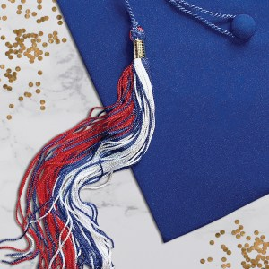 Royal blue cap with red, white and blue tassel