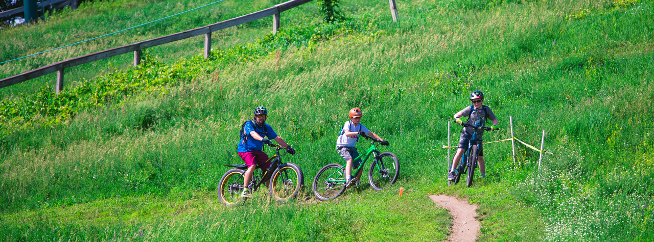 Three people mountain biking at Buck Hill