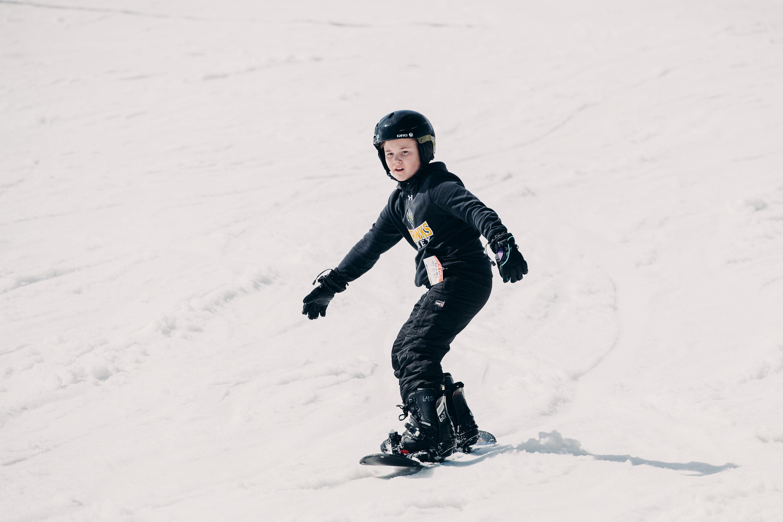 child snowboarding