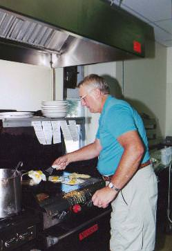 Firefighter cooking up breakfast at Riegelsville Fire Co.