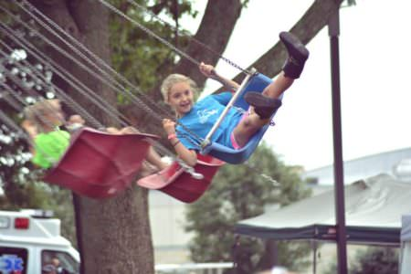 Girl on a swing at a past Polish-American Festival
