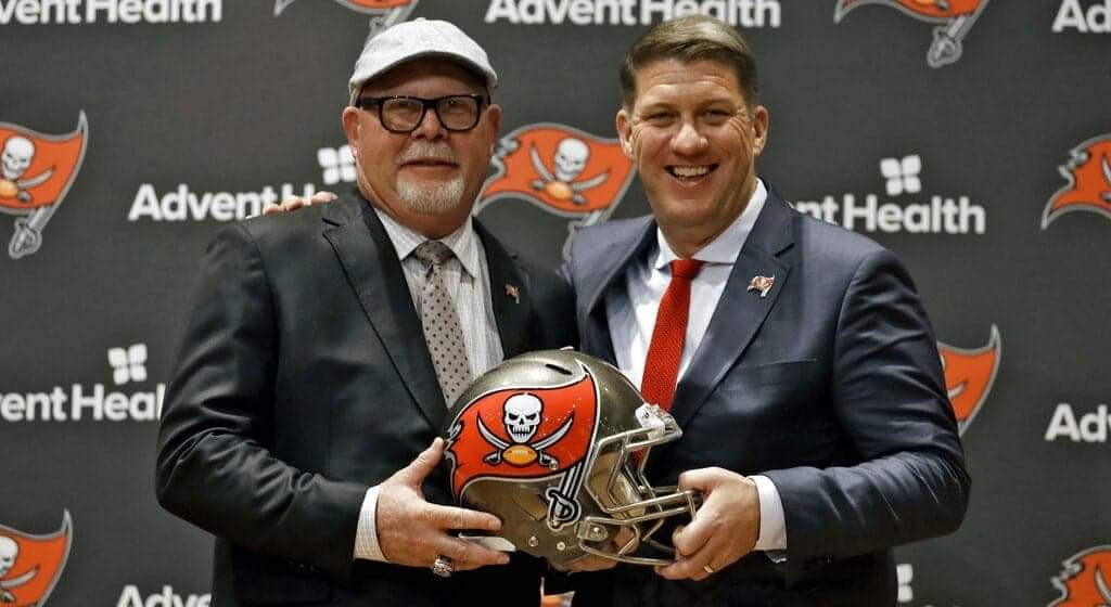 Tampa Bay Buccaneers head coach Bruce Arians, left, smiles as he stands with general manager Jason Licht after Arians was introduced during a news conference Thursday, Jan. 10, 2019, in Tampa, Fla. (AP Photo/Chris O'Meara)