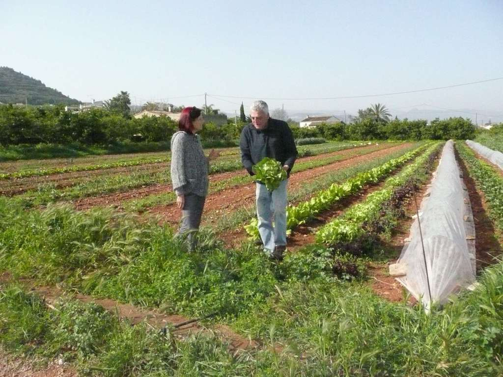 Anasha with our farmer friend in Denia, where we went every Saturday for years to buy fresh, organic fruits and veggies