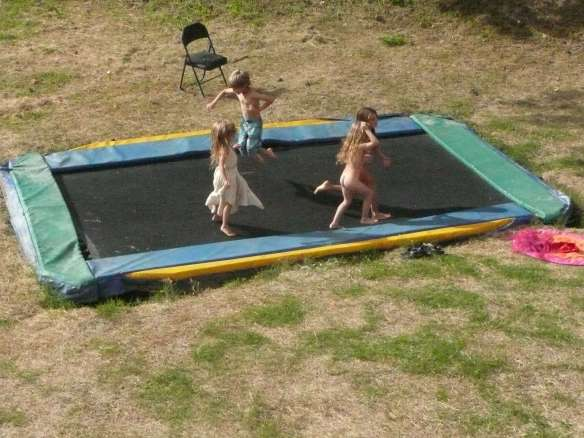 the trampoline is huge and sunk in the ground... some people are like acrobats around here...