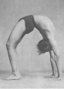 Urdhva Dhanurasana, or Upward-Facing Bow Pose