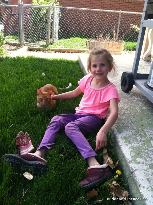 Alayna relaxing with Yoda the cat.