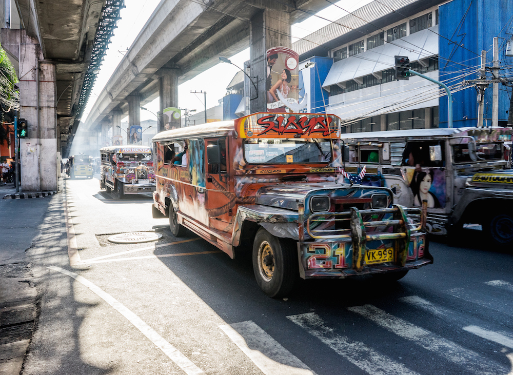 Jeepneys-Manila-Cubao-traffic-travel-philippines-vintage-buddha-drinks-fanta-jenny-adams-04161